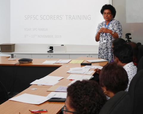 EQAP's Curriculum and Assessment team leader Mere Vadei takes SPFSC scorers through a refresher course on SOLO taxonomy.